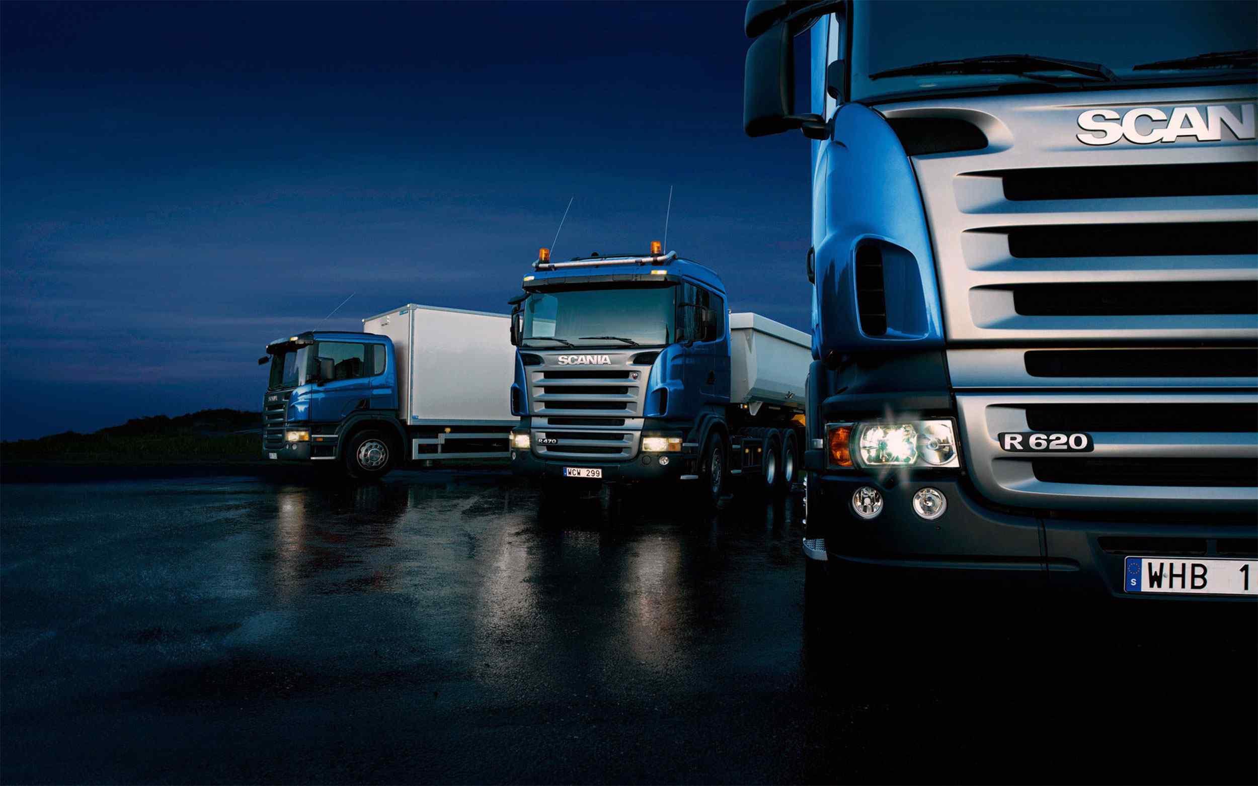 Three-trucks-on-blue-background.jpg